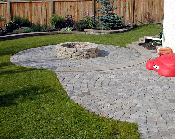 Brick Patio with stone fire pit - Paving Stone Patios- Stone Taffy Design